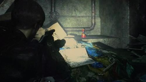 Cherchez Statues Mr. Raccoon Resident Evil 2 Remake compagne Leon